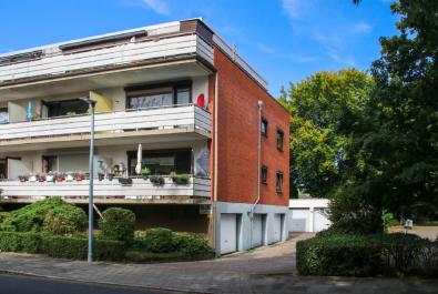 Helle Wohnung mit riesiger Dachterrasse! Mit Garage, Einbauküche und neuwertigem Duschbad!
